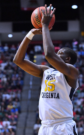 SAN DIEGO, CA - MARCH 18:  West Virginia Mountaineers forward Lamont West (15) shoots against the Marshall Thundering Herd during a second round game of the Men's NCAA Basketball Tournament at Viejas Arena in San Diego, California. West Virginia won 94-71.  (Photo by Sam Wasson)