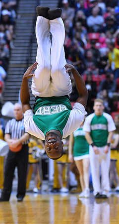 SAN DIEGO, CA - MARCH 18:  A Marshall Thundering Herd cheerleader performs during a second round game of the Men's NCAA Basketball Tournament against the West Virginia Mountaineers at Viejas Arena in San Diego, California.  (Photo by Sam Wasson)