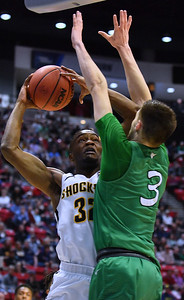 SAN DIEGO, CA - MARCH 16:  Markis McDuffie #32 of the Wichita State Shockers shoots against Jannson Williams #3 of the Marshall Thundering Herd during a first round game of the Men's NCAA Basketball Tournament at Viejas Arena in San Diego, California. Marshall won 81-75.  (Photo by Sam Wasson)