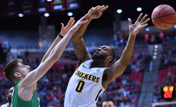 SAN DIEGO, CA - MARCH 16:  Rashard Kelly #0 of the Wichita State Shockers loses the ball against Ajdin Penava #11 of the Marshall Thundering Herd during a first round game of the Men's NCAA Basketball Tournament at Viejas Arena in San Diego, California. Marshall won 81-75.  (Photo by Sam Wasson)