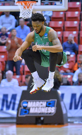SAN DIEGO, CA - MARCH 16:  C.J. Burks #14 of the Marshall Thundering Herd warmps up before a first round game of the Men's NCAA Basketball Tournament against the Wichita State Shockers at Viejas Arena in San Diego, California. Marshall won 81-75.  (Photo by Sam Wasson)