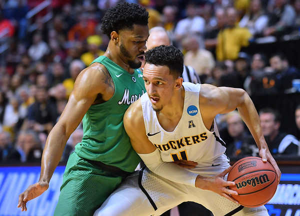 SAN DIEGO, CA - MARCH 16:  Landry Shamet #11 of the Wichita State Shockers looks to drive against C.J. Burks #14 of the Marshall Thundering Herd during a first round game of the Men's NCAA Basketball Tournament at Viejas Arena in San Diego, California. Marshall won 81-75.  (Photo by Sam Wasson)