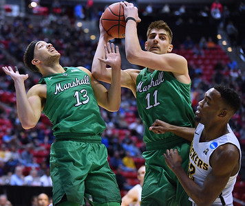 SAN DIEGO, CA - MARCH 16:  Ajdin Penava #11 of the Marshall Thundering Herd grabs a rebound against Markis McDuffie #32 of the Wichita State Shockers during a first round game of the Men's NCAA Basketball Tournament at Viejas Arena in San Diego, California. Marshall won 81-75.  (Photo by Sam Wasson)