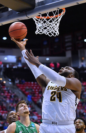 SAN DIEGO, CA - MARCH 16:  Shaquille Morris #24 of the Wichita State Shockers scores on a layup during a first round game of the Men's NCAA Basketball Tournament at Viejas Arena in San Diego, California. Marshall won 81-75.  (Photo by Sam Wasson)