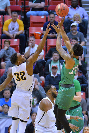 SAN DIEGO, CA - MARCH 16:  C.J. Burks #14 of the Marshall Thundering Herd shoots against Markis McDuffie #32 of the Wichita State Shockers during a first round game of the Men's NCAA Basketball Tournament at Viejas Arena in San Diego, California. Marshall won 81-75.  (Photo by Sam Wasson)