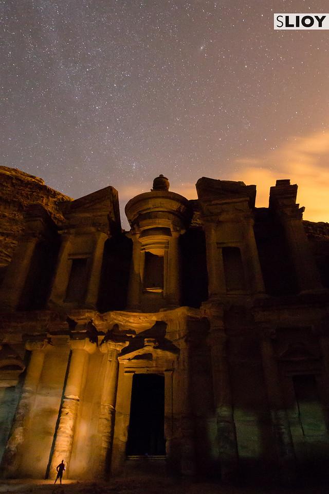 Petra Monastery at night with stars in Jordan.