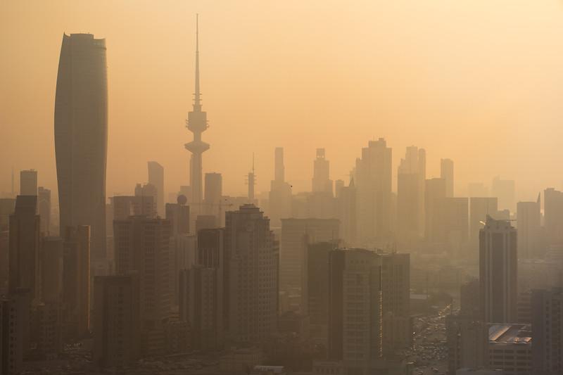 Kuwait City skyline on a sandy day in the desert.