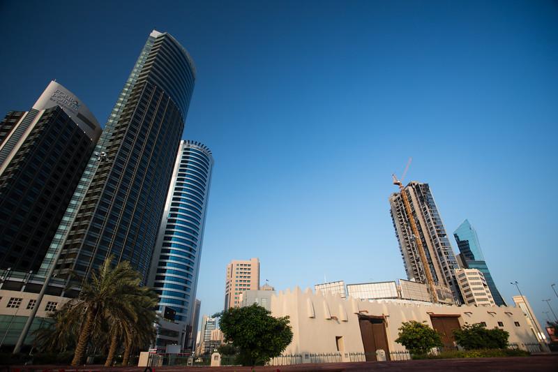 Al Jahra Gate and skyscrapers of Kuwait City, Kuwait.