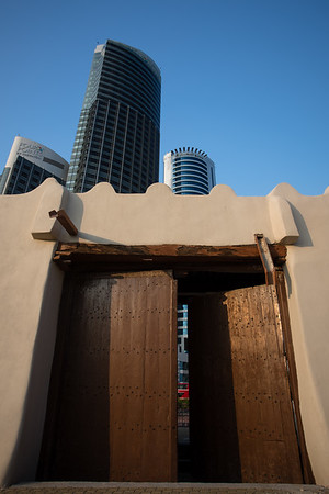 Al Jahra Gate and skyscrapers of Kuwait City, Kuwait.