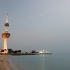 View of the Kuwait Towers illuminated as night falls in Kuwait City, Kuwait.