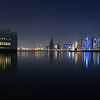 Reflected panorama of the Museum of Islamic Arts and West Bay in Doha, Qatar.
