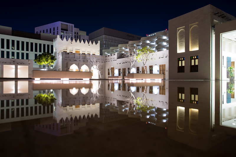Reflections of traditional architecture and modern structures in the Msheireb area of Doha, Qatar.