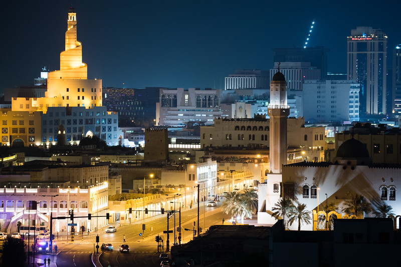 The Islamic Center of Doha towers over the Souq Waqif market area of Doha, Qatar.