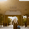 A local man in traditional clothing walks across Al Safa Square in Riyadh, Saudi Arabia.