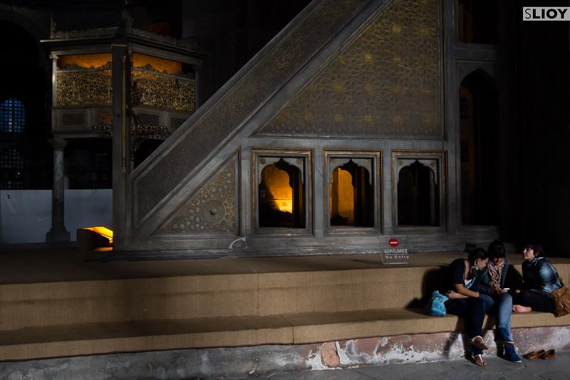 Tourists take a break inside the Hagia Sophia in Istanbul Turkey.