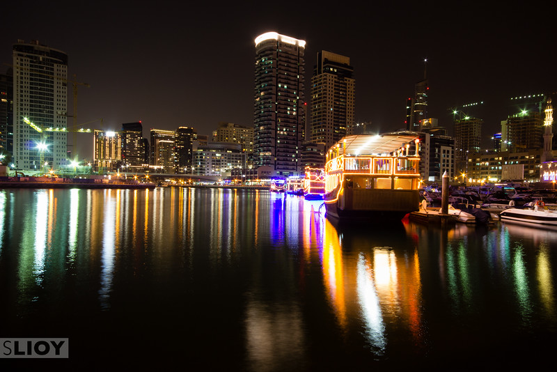 A traditional Dhow boat bobs quietly at the end of the Dubai Marina while awaiting an evening's cruise.