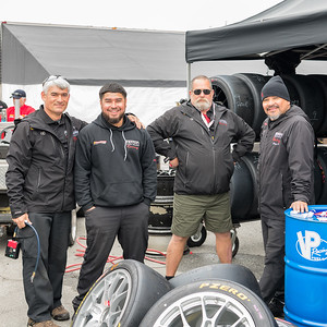 The Ferrari Long Island Racing crew knows how to pose for a picture