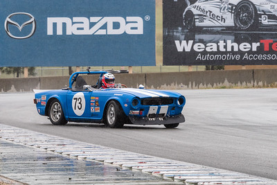 1970 Triumph TR6 of Walter Hollowell sliding through Turn 11