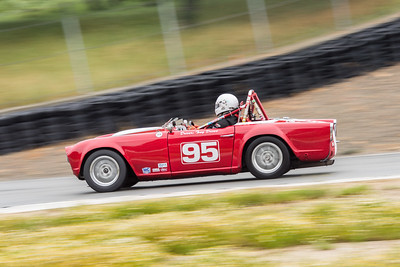 1964 Triumph TR4 of Tony Drews into Turn 9