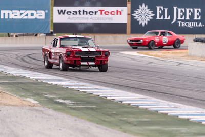 Mustang leads Camaro out of Turn 11