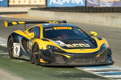 Closeup of K-Pax McLaren 650S heading down the front straight