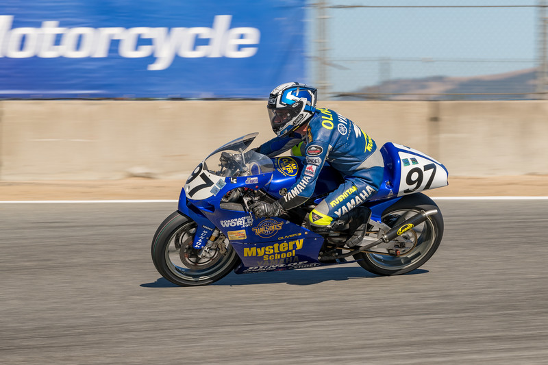 Rich Oliver on the #97 Yamaha TZ250 braking for the Corkscrew