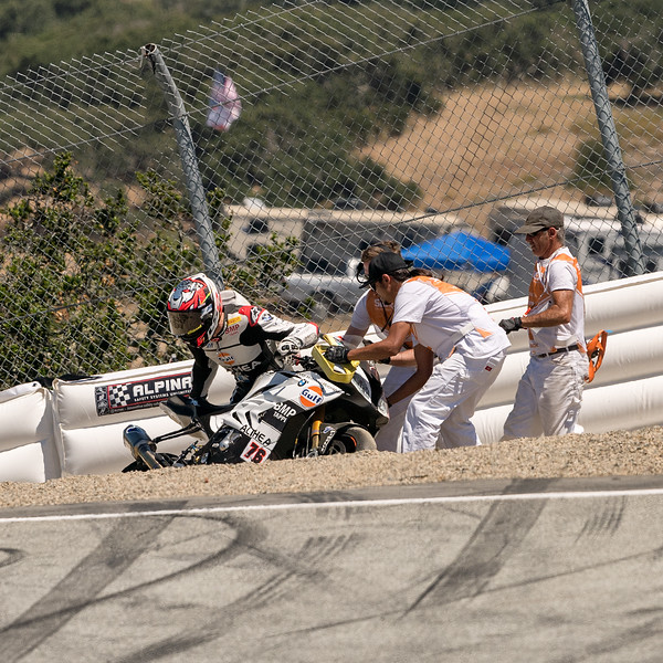 Loris Baz #76 BMW S1000R sliding out entering the Corkscrew (3 of 3)