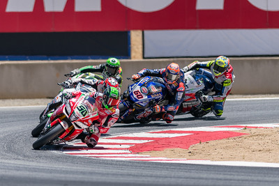 Eugene Laverty on the #50 Aprilia RSV4 RF leads the pack out of Turn 11