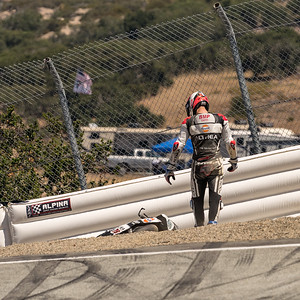 Loris Baz #76 BMW S1000R sliding out entering the Corkscrew (2 of 3)