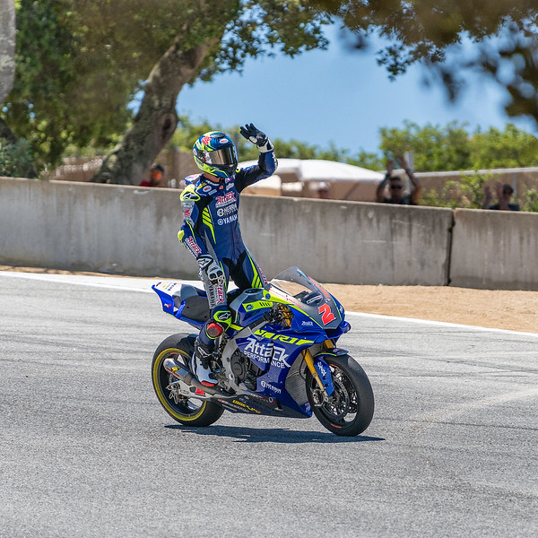 Josh Herrin celebrates pole position with fans in the Corkscrew