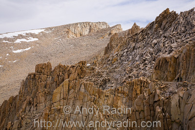 This is the scene on the western side of the Sierra crest.  In stark contrast to the sheer cliffs of the east, here it's all broken jumples of shallow-sloped boulders and talus