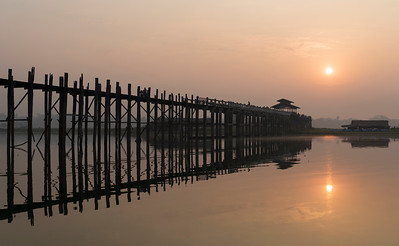 Sunrise over the U Bein Bridge - the longest teakwood footbridge in the world in Amarapura near Mandalay, Burma (Myanmar)
