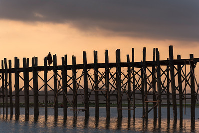 U Bein Bridge - longest teakwood footbridge in the world - crossing the Taungthaman Lake in Amarapura near Mandalay, Burma (Myanmar)