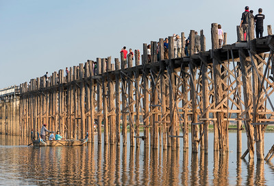 Tourists at U Bein Bridge - the longest teakwood footbridge in the world, Amarapura near Mandalay, Burma (Myanmar)
