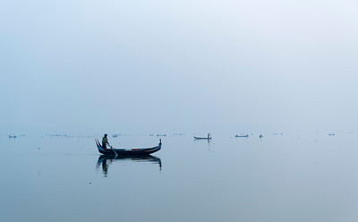 Fishing boats on Taungthaman Lake in Amarapura near Mandalay, Burma (Myanmar)