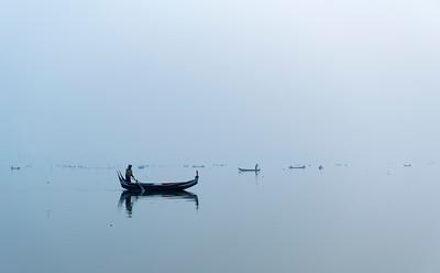 Fishing boats on Taungthaman Lake in Amarapura near Mandalay, Burma (Myanmar)