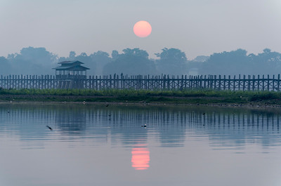 Sunrise over the U Bein Bridge - the longest teakwood footbridge in the world in Amarapura near Mandalay, Burma (Myanmar)