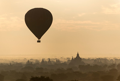 Hot-air Balloon in flight over temples of Bagan, Burma - Myanmar