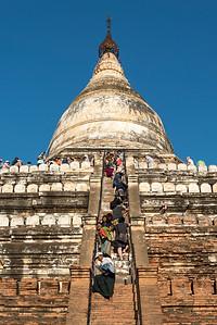 Visitors climb steep steps of Shwesandaw Pagoda, Bagan, Burma - Myanmar