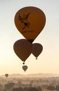 Hot-air Balloons in flight over temples of Bagan as seen from Pyathada Paya, Burma - Myanmar