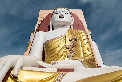 Low-angle view of Buddha statue at Kyaikpun Pagoda in Bago, Burma (Myanmar)