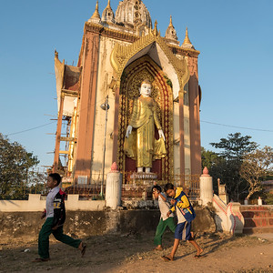 School-children outside Laymyatnar Pagoda, Bago, Myanmar (Burma)
