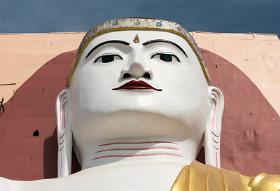 Face of Buddha statue at Kyaikpun Pagoda in Bago, Burma (Myanmar)