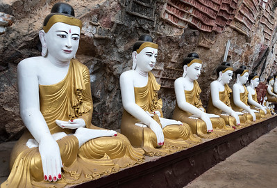 Line of Buddha statues at Kaw-goon (or Kawgun) Cave Temple, Mon State, Burma (Myanmar)