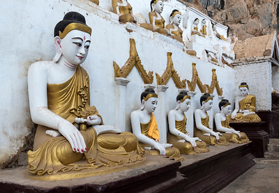 Line of Buddha statues at Kaw-goon (or Kawgun) Cave Temple, Mon State, Burma (Myanmar)
