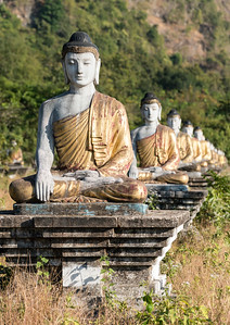 Buddha statues lined up in rows under Mt Zwegabin, Hpa-an, Karen (Kayin) State, Burma