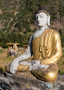Close-up of Buddha statue at the foot of Mt Zwegabin, Hpa-an, Karen (Kayin) State, Burma