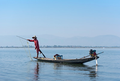 Intha fisherman throwing net, Inle Lake, Burma (Myanmar)