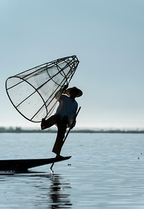 Intha fisherman with traditional conical fishing net, Inle Lake, Burma (Myanmar)