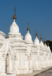 Row of whitewashed stone-inscription caves at Kuthodaw Pagoda in Mandalay, Burma (Myanmar)